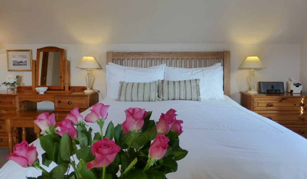 "The ""Drimnin"" bedroom with fresh flowers"